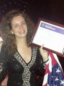 U.S. Team member Kelli Etheredge holds her award with pride